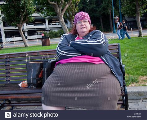 fat lady on bench obese lady on park bench san francisco california stock