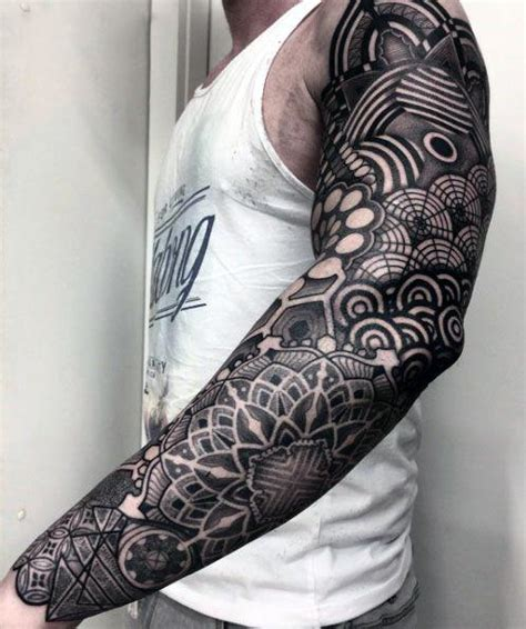 tattoo arm all 70 all black tattoos for men blackout design ideas