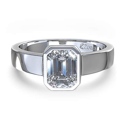 emerald cut bezel set engagement ring in 14k white
