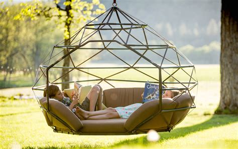 Modern hanging chairs take the coziness outside