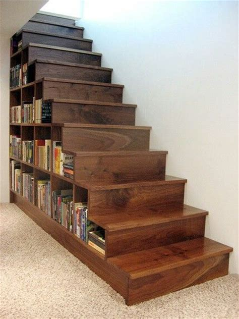 bookshelf built into stairs for the basement