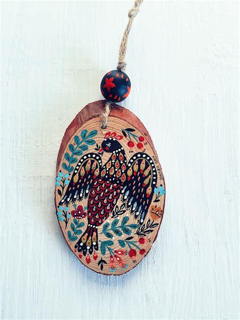 folk inspired holiday ornaments hand painted by dinara