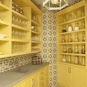 mustard kitchen cabinets yellow and gray backsplash tiles design ideas