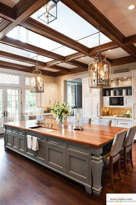 home plans with large kitchens this large kitchen has an island that doubles as a table and sky lights above to bring in the