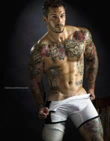 red flowers tattoos on man chest tattooed men