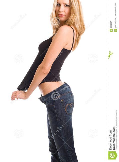 girl pulling down her shirt lovely girl pulling black shirt royalty free stock