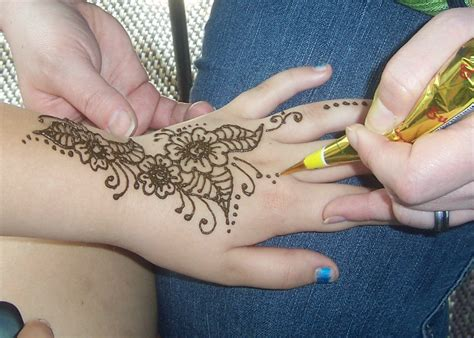 traditional henna application wild style design company