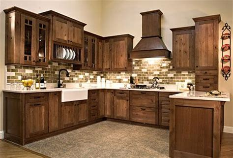 this kitchen has rustic alder cabinetry with a coffee