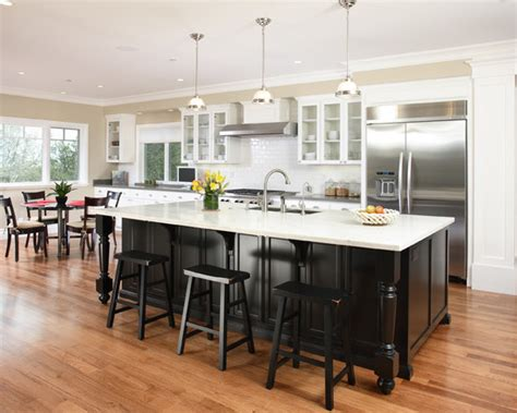 white kitchen black island white kitchen cabinets black island black stools subway