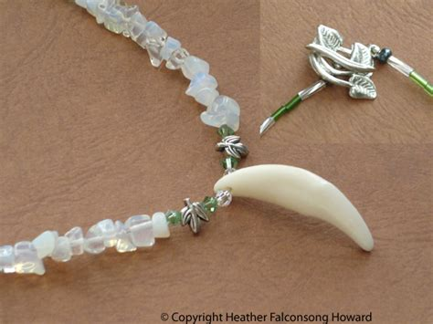 wolf tooth necklace details by falconsong on deviantart