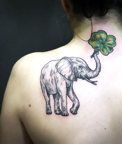 elephant tattoo on shoulder blade elephant with clover on shoulder blade tattoo idea