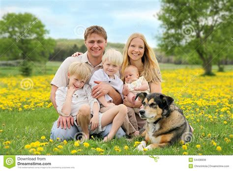 Nel Images by Happy Family And Pet In Flower Meadow Stock Image