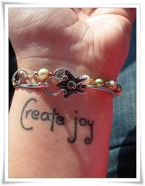 12 joy wrist tattoos