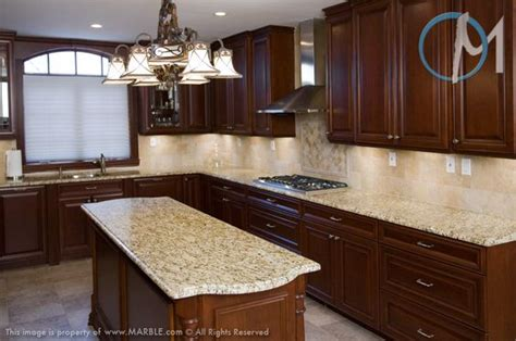 dark cabinets with new venetian gold granite and tumbled