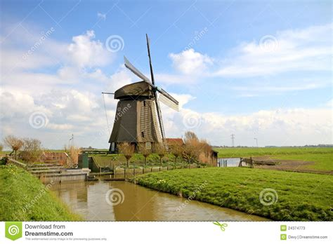 European House Plans With Photos by Traditional Windmills In Dutch Landscape Stock Photos