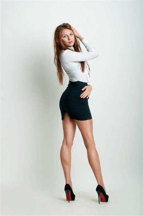 skirt and high heels model with great legs wearing a fabulous mini skirt and