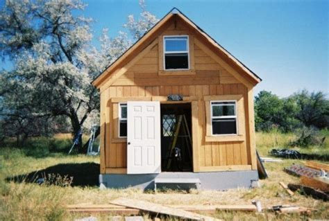 house tour a diy self sustainable micro cabin in cali author builds tiny solar powered off grid cabin for under