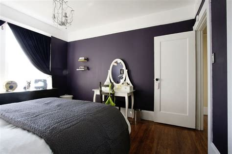 purple wall color with vintage white vanity table and black comforter for interesting