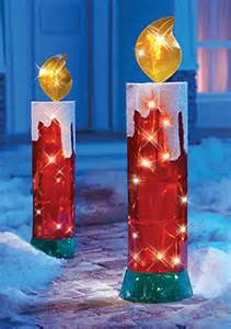 giant lighted candle outdoor christmas decoration