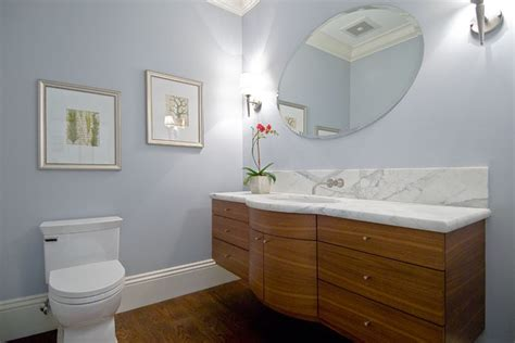 floating curved vanity with stained horizontal grain beech