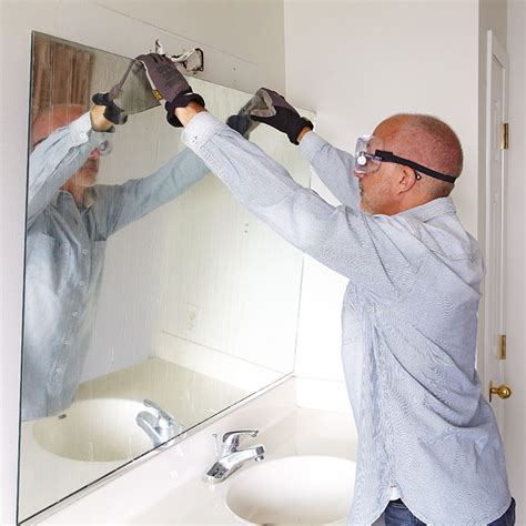 how to install a bathroom mirror with glue remove a bathroom mirror