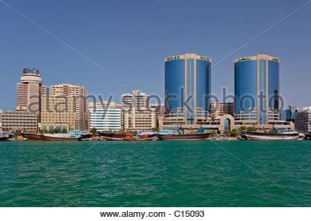 dubai boat tower the dubai creek skyline office towers with dow boats in