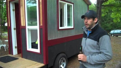a 60 square foot tiny house cer cabin on wheels with a