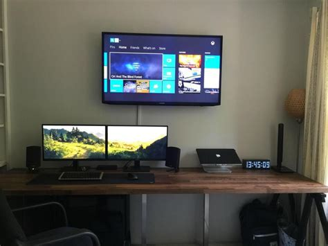 office desk with tv mount dual monitors on wooden desk with wall mounted tv 10