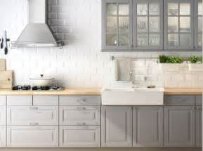 Grey kitchen cabinets white backsplash possibly an accent for a