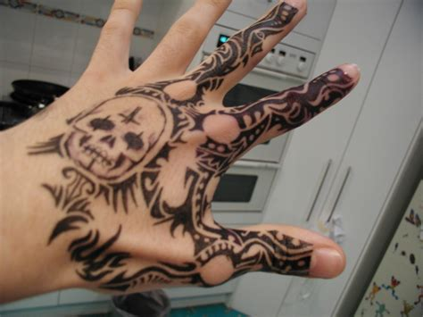 215 tattoo on hand meaning tattoo hand 13 by nickthomson on deviantart