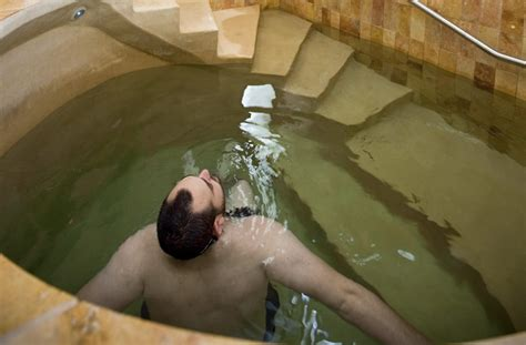 communal bathroom meaning more men making monthly mikvah dunks as menstrual rite