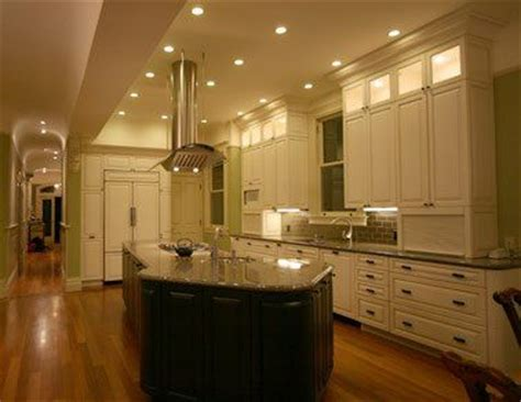 white and brown kitchen cabinets love the illuminated upper cabinets finished off with