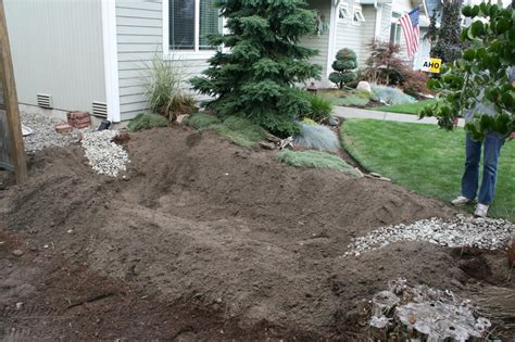 how to stop water runoff from neighbors yard how to build a garden diy network made