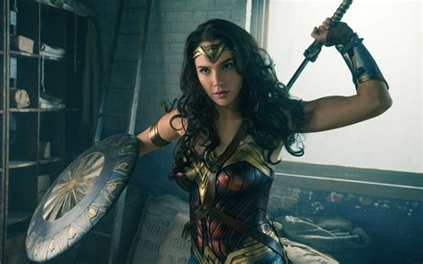 film film gal gadot gal gadot says wonder woman will be straight as quot she falls