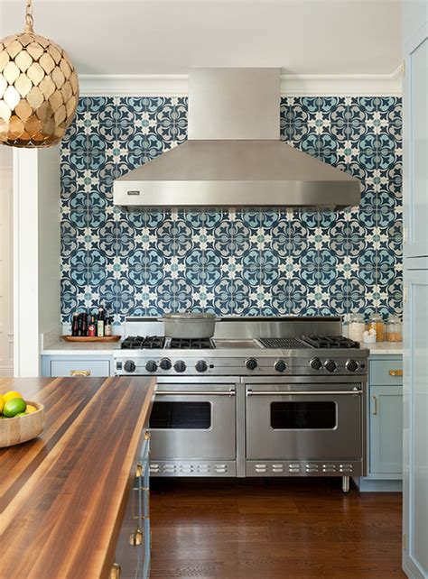 blue kitchen cabinets with blue mosaic tile backsplash