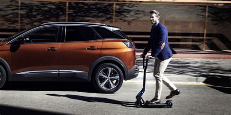 peugeot electric scooter all new peugeot 3008 suv comes with e kick electric scooter