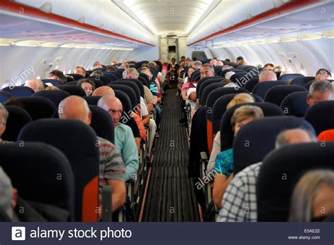 easyjet cabin passengers inside cabin of easyjet airbus a319 stock photo