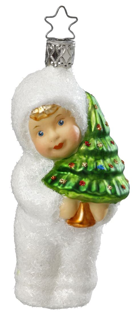kinder of tradition child with christmas tree ornament