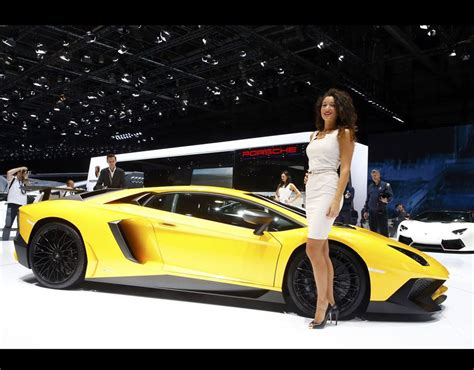 Next Lamborghini Model Poses Next To A Lamborghini Aventador Sv Sports Car