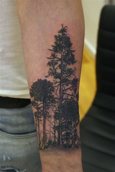 fantastic simple forest forearm tattoo for men