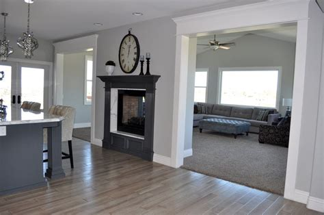 Grey Walls With Wood Floors by Grey Hardwood Floors And Sided Fireplace