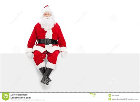 santa claus sitting on a blank billboard stock photo