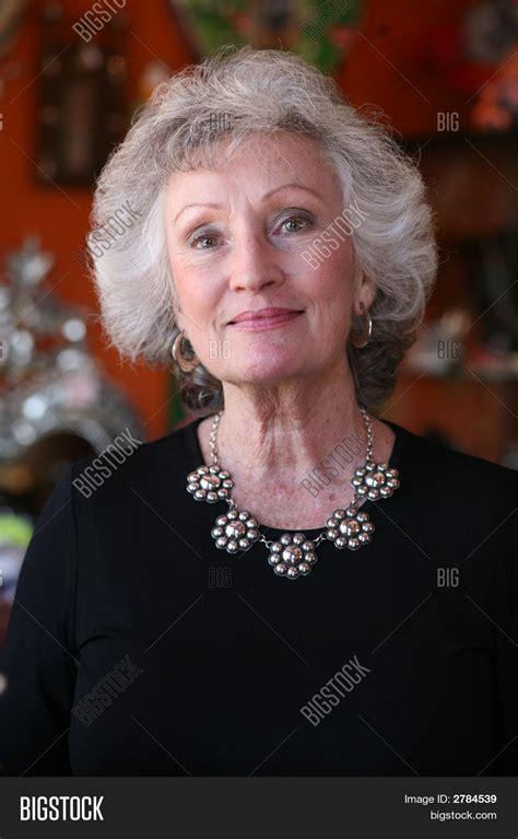 older women wearing jewelry mature woman wearing silver jewelry stock photo stock