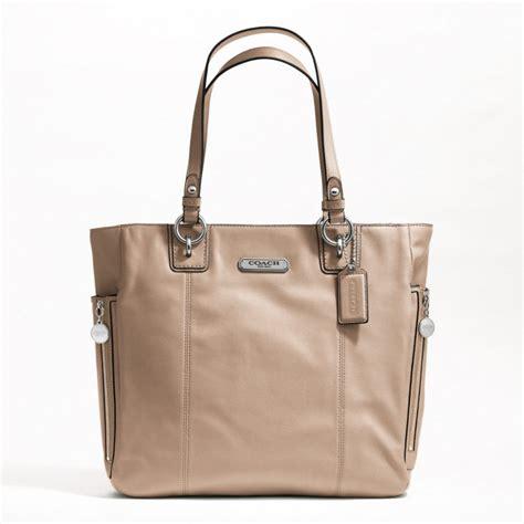 couch hand bag coach legacy bag car interior design