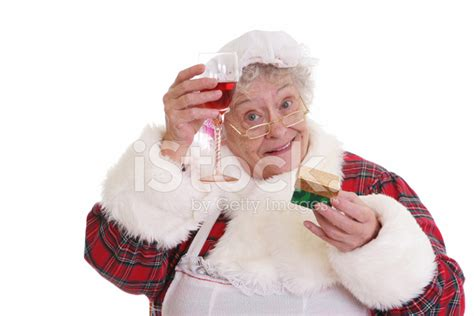 christmas senior mrs claus holding gift and wine stock