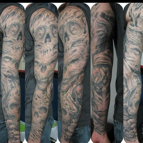black and grey religious sleeve of tattoos religious black and grey