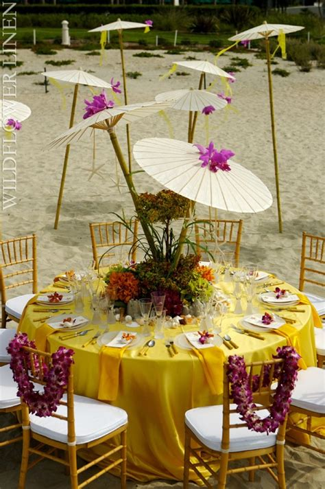 yellow hues on the creates a tropical feel orange yellow wedding ideas