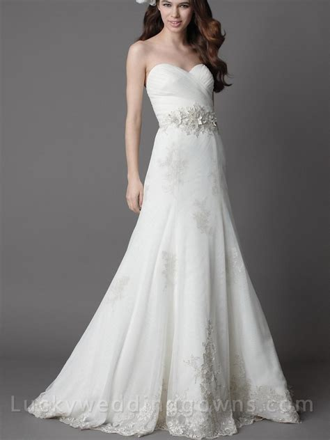 white strapless chapel wedding dress with a