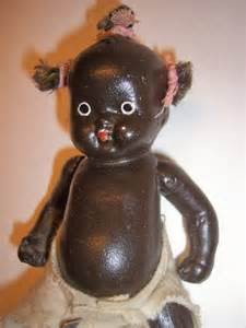 Antique all bisque black baby doll made in japan completed