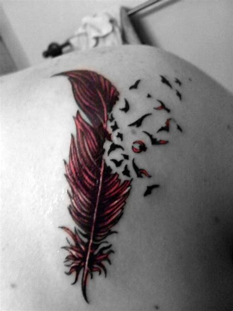 tattoo feather into birds meaning feather into birds tattoo meaning tattoos pictures